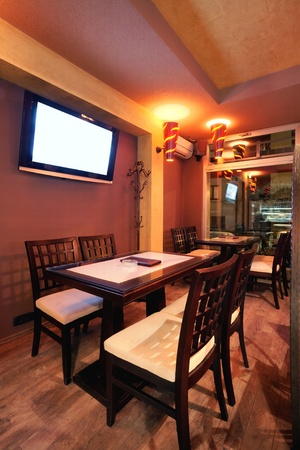 Interior of a restaurant, modern design in few colors, orange and brown   photo
