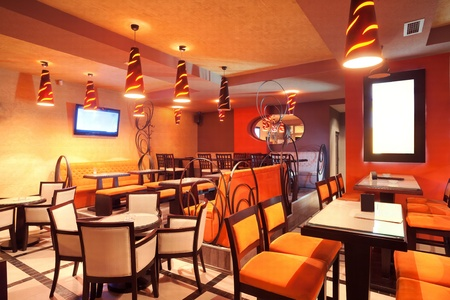 Interior of a restaurant, modern design in few colors, orange and brown   Stockfoto