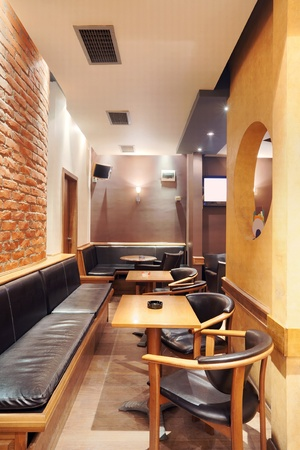Modern and simple cafe interior with wooden classical furniture.  photo
