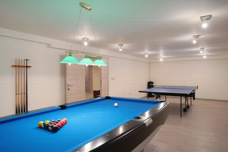 pool game: Interior of an entertainment room, billiard and tenis table details.  Stock Photo