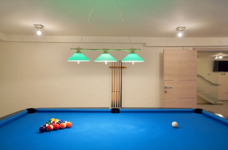 snooker room: Interior of an entertainment room, billiard and tenis table details.  Stock Photo