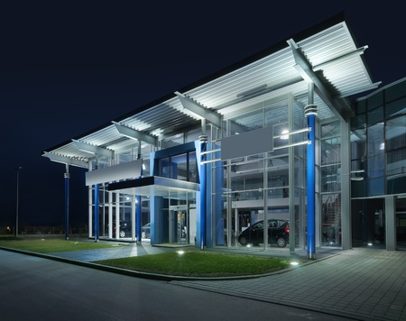 outdoor lighting: Exterior of a modern car salon, night scene.  Stock Photo
