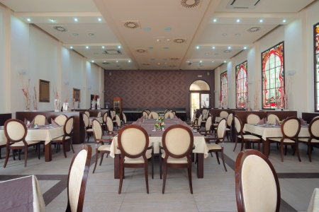Interior of a hotel restaurant during day. photo