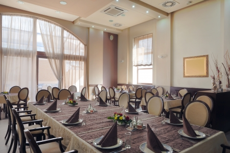 Interior of a hotel restaurant during day. Stock Photo - 14248252