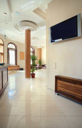 tv wall: Interior of a hotel, view on reception and waiting room.  Stock Photo