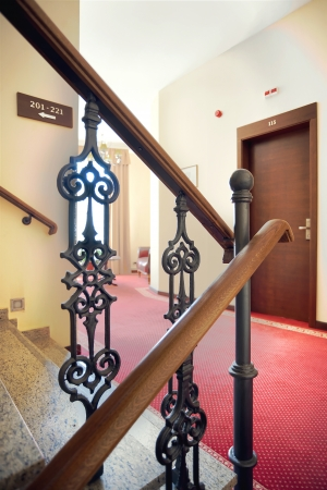 Interior of a hotel, view on stairs gate.  photo