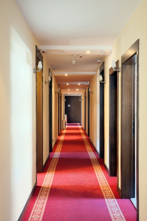 Interior of a hotel, view on a hall, classical look, doors and lamps.  photo