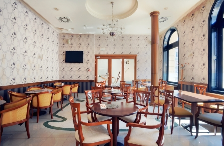 Interior of a restaurant, vintage style, during day.  photo
