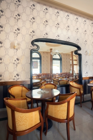 One part of a restaurant, view on a table and armchairs, vintage style.  photo