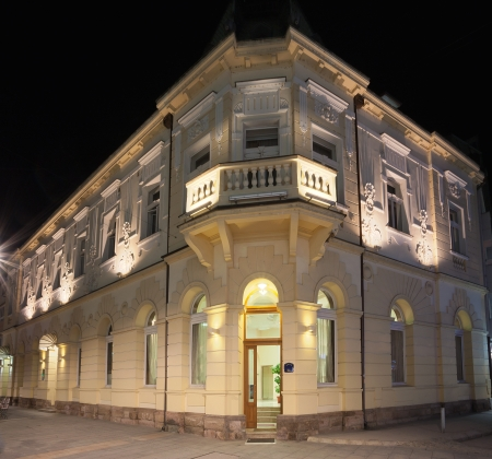 Exterior of an old hotel during night.  photo