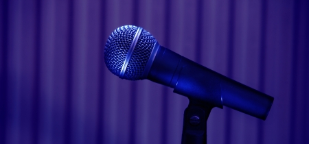 Stage microphone details on purple background.  photo