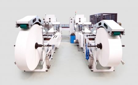 handkerchiefs: Details of a printing machine for handkerchiefs viewed from the front.