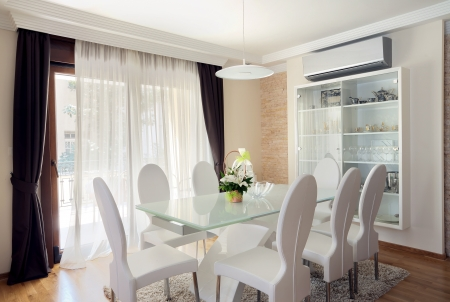 dining table and chairs: Interior of a modern dining room.  Stock Photo