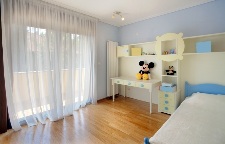 Interior of a kid bedroom, simple, modern and new.  photo