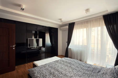Interior of a modern bedroom, black and white design.