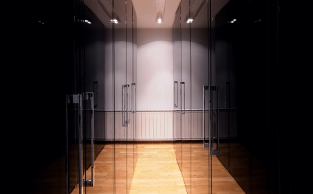 Interior of a simple and large wardrobe in black.  photo