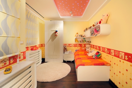 Interior of a kid room, modern design, with furniture and toys all around.  Stock Photo