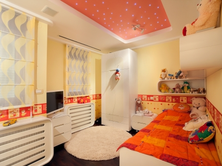 bedroom bed: Interior of a kid room, modern design, with furniture and toys all around.  Stock Photo