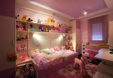 Interior of a kid room, modern design, with furniture and toys all around.  photo