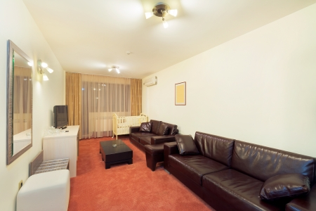 Interior of a hotel apartment, set for family.  photo
