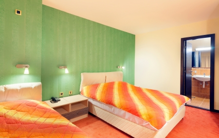 Interior of a hotel apartment, room with green wallpapers.  photo