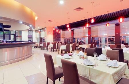 Modern restaurant interior, part of a hotel, night scene.