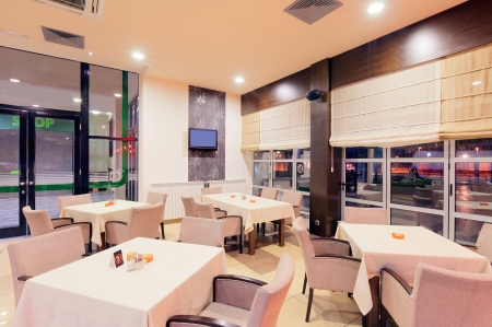 Modern restaurant interior, part of a hotel, night scene. photo