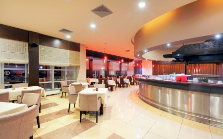 Modern restaurant interior, part of a hotel, night scene.