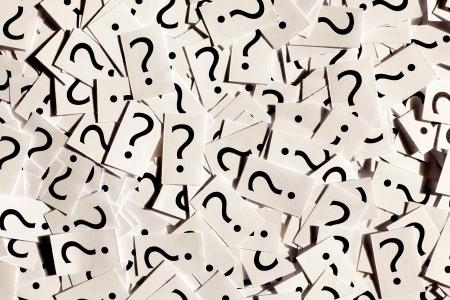signo de interrogacion: Sólo un montón de signos de interrogación en los libros blancos Foto de archivo