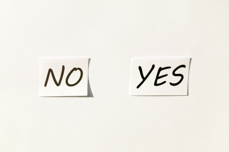Just two pieces of paper with yes and no on it   Stock Photo - 17470419