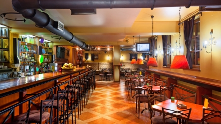 pub: Interior of a modern pub in orange and wooden colors.