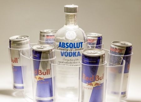 Cacak, Serbia - May 20, 2013: Six Red Bull Cans and Absolut Vodka, studio isolated.