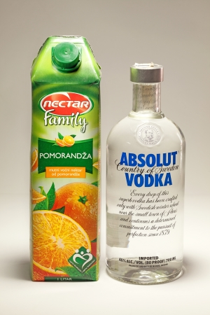 vodka bottle: Cacak, Serbia - May 20, 2013: Orange Juice and Absolut Vodka, studio isolated.