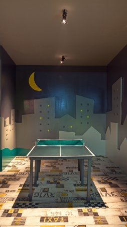 game room: Interior of a game room with tennis table. Stock Photo