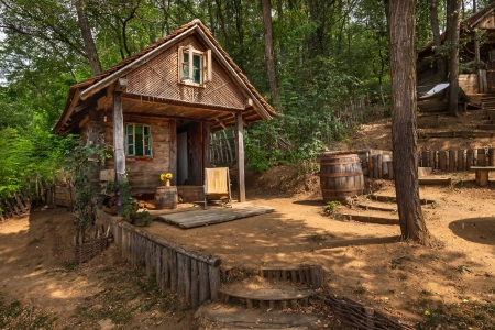 Wooden house in forest, house made of natural materials. Stock Photo - 22020390
