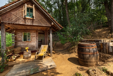 Wooden house in forest, house made of natural materials. Stock Photo - 22020389