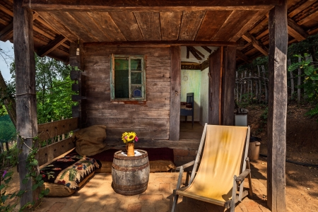 Wooden house in forest, house made of natural materials. Stock Photo - 22020391