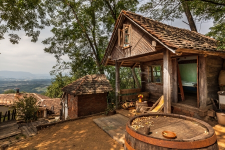 Wooden house in forest, house made of natural materials. Stock Photo - 22020392