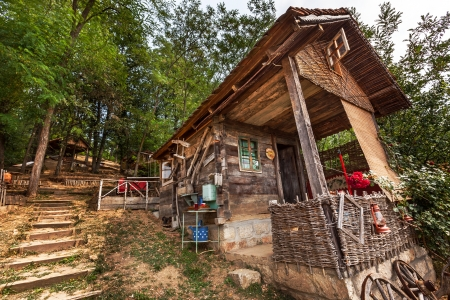 Wooden house in forest, house made of natural materials.  Stock Photo - 22020418