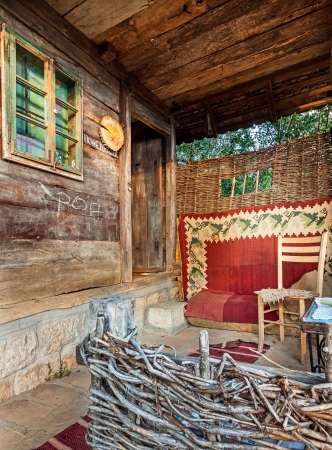 Wooden house in forest, house made of natural materials.  Stock Photo - 22020421