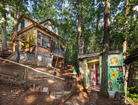 Wooden house in forest, house made of natural materials. Stock Photo - 22020424
