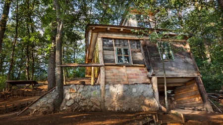 Wooden house in forest, house made of natural materials. Stock Photo - 22020425