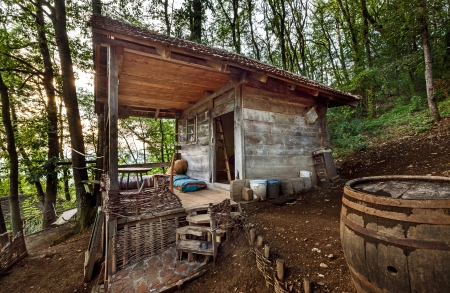 Wooden house in forest, house made of natural materials. Stock Photo - 22020429