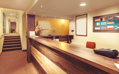 Interior and details of a small hotel reception.  Stock Photo