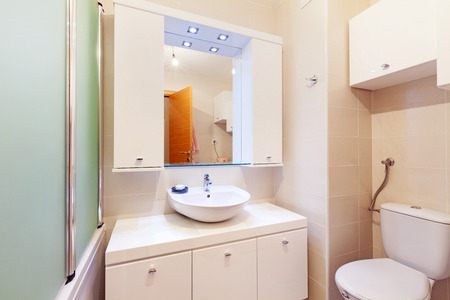 Small apartment bathroom, new in white, clean and modern   photo