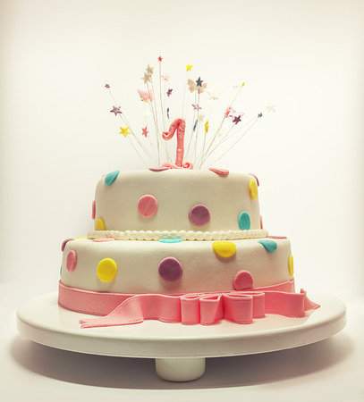 1st birthday: Cake for first birthday, number one made of sugar on top with stars around it   Stock Photo