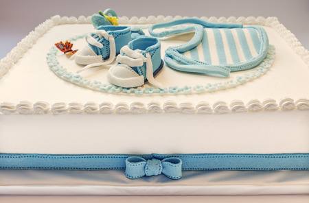 first birthday: Birthday cake for baby, blue and white design, on light gray  Stock Photo