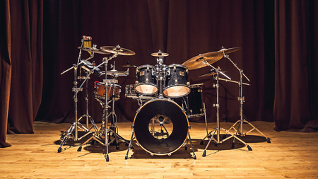 Modern drum set on stage prepared for playing.