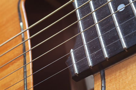 Part of a gipsy guitar, old fashioned acoustic guitar in macro view. photo