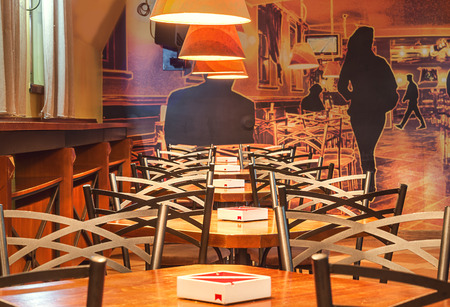 illustrative: Cacak, Serbia - January 23, 2015: Velvet Cafe and Club interior, modern design with vintage chairs and tables and illustrative wallpapers. Editorial